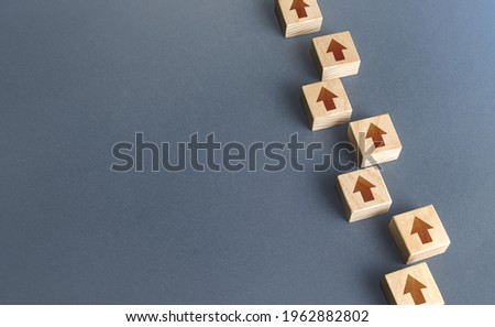 Chain of blocks of unidirectional arrows. Consistency and focus. Concept of conformism, vertical of power. Unchanging course of development. Following canons and traditions. Building a solid strategy. Royalty-Free Stock Photo #1962882802
