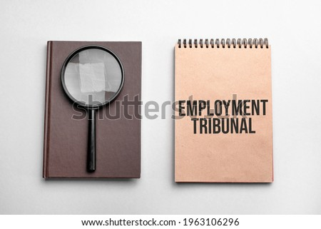 Craft colour notepad with text employment tribunal. Notepad with , magnifying glass. Business concept Royalty-Free Stock Photo #1963106296