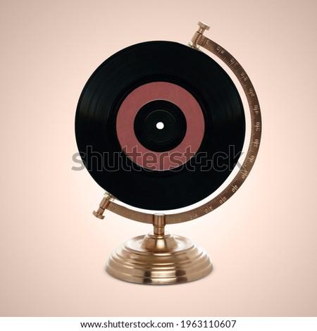 record or lp on globe stand - international music, world jazz day,  jazz day, jazz, old disk, vinyl music disks,world music day
