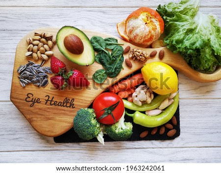 Food for healthy eyes and good eyesight. Natural products to boost eye health and improve eyesight. Assortment of food for good vision. Fresh fruit and vegetable rich in antioxidant, lutein zeaxanthin Royalty-Free Stock Photo #1963242061
