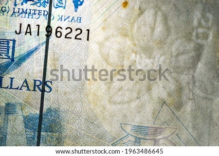 Horizontal closeup detail of obverse side of twenty 20 Hong Kong dollars HKD banknote with translucent flower watermark and security features, Hong Kong 20 Dollars Banknote, 2009