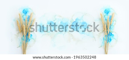 Creative image of beautiful wheat crops on artistic ink background. Top view with copy space. Symbols of jewish holiday - Shavuot Royalty-Free Stock Photo #1963502248