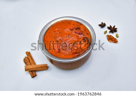 Chicken Tikka Masala curry hot and spicy gravy dish in copper Kadai wooden background in Punjab, Hyderabad Kashmir North India. Top view popular Indian curries nonveg food for Paratha, Roti