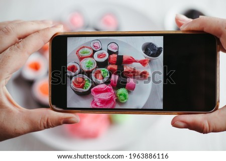 Micro plastic in ocean global problem. Contamination of food and water, environmental pollution. Taking picture of artificial food products made of plastic bags. Human health and nutrition