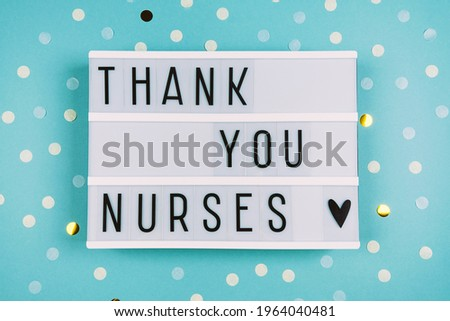 Lightbox with an inscription on a blue background. Greeting card for International Nurse Day. Medical background