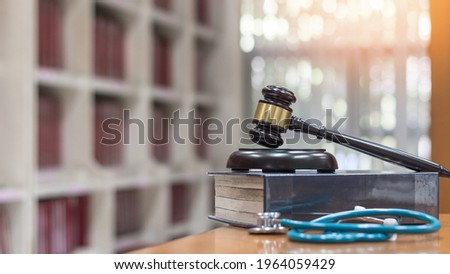 Forensic medicine science, criminalistics legal investigation or medical practice justice concept with judge gavel on law text book for criminal and civil laws in school class or library Royalty-Free Stock Photo #1964059429