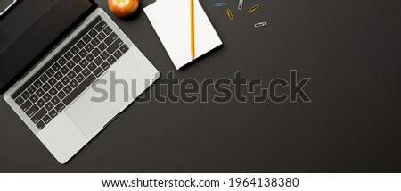 Top view, 3D rendering, dark study table with laptop, stationery, apple and copy space on black table, 3D illustration