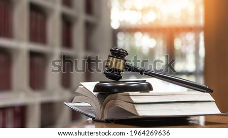 Law, legal judgement, legistration, litigation, court verdict, judicial system and civil right and social justice concept with judge gavel on law textbook in attorney law firm, lawyer business office Royalty-Free Stock Photo #1964269636