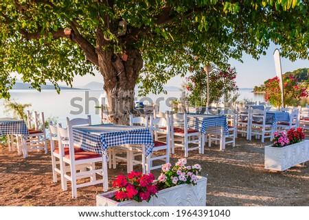 Lefkada, Greece. Seaside taverna on a sunny morning. Royalty-Free Stock Photo #1964391040