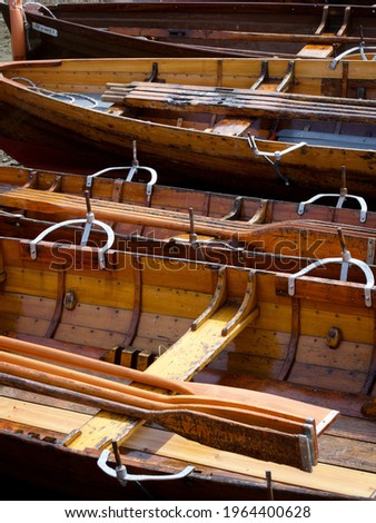 Vintage Wooden Rowing Boats with Oars Royalty-Free Stock Photo #1964400628
