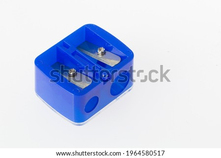 double pencil sharpener, blue color, on white background, close-up image