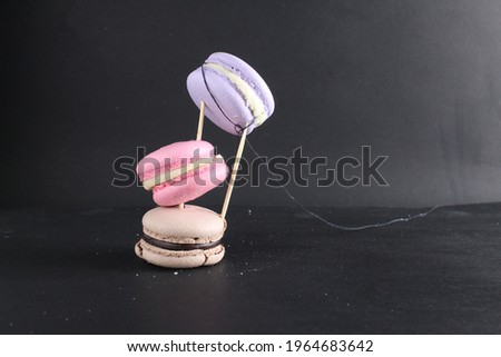Levitating food. Before processing photoshop macaroons on a black background.