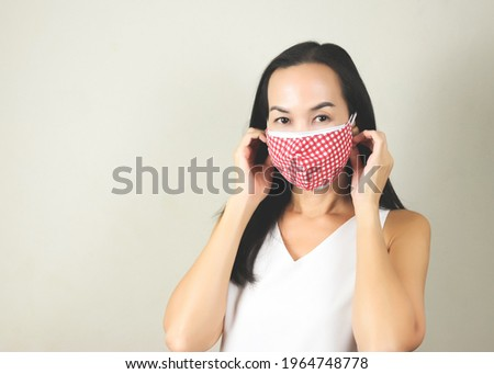 Portrait of Asian woman wearing  double face masks or two face masks to protect from coronavirus or covid-19 outbreak. concept of safety, healthcare, medical and hygiene. Royalty-Free Stock Photo #1964748778