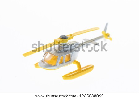 Yellow toy helicopter on a white background