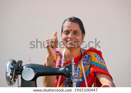 Rural woman Worker Tailor showing Thumbs Up  Royalty-Free Stock Photo #1965100447