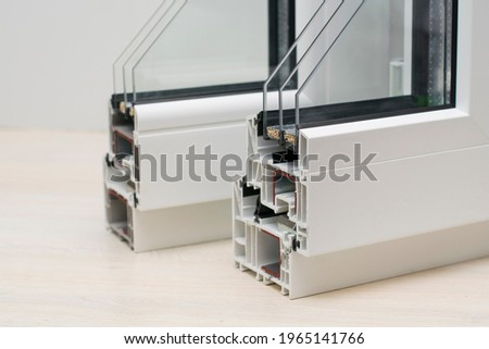 Samples of plastic windows in a section. close-up. PVC window profiles and double-glazed windows, sectional exhibition samples. Energy saving technologies, plastic pvc windows, copy space. Royalty-Free Stock Photo #1965141766