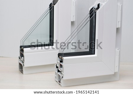 Samples of plastic windows in a section. PVC window profiles and double-glazed windows for exhibition, sectional samples. Energy saving technologies, plastic pvc windows. Royalty-Free Stock Photo #1965142141
