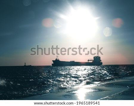 ships on sea during sunset Royalty-Free Stock Photo #1965189541