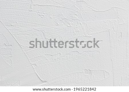White texture of stucco background, photography backdrop, light grunge flat lay tabletop for food or product photo