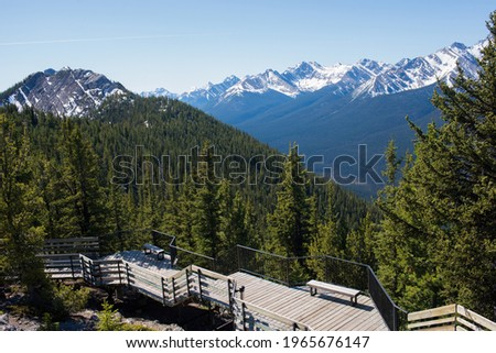 Wooden footpath with a beautiful view of Rocky Mountains. Banff National Park, Alberta, Canada Royalty-Free Stock Photo #1965676147