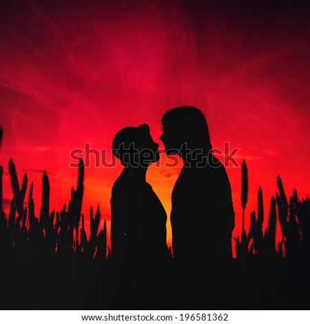 loving beautiful couple of guys and girls at sunset in field #196581362