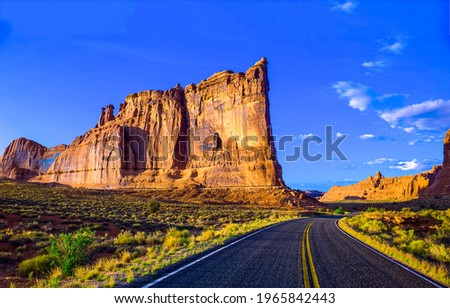 Canyon road in sunny day. Road in canyon. Canyon road landscape. Canyon road panorama Royalty-Free Stock Photo #1965842443