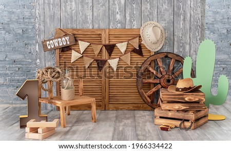 Cowboy first birthday Digital Background. Festive decoration for birthday. Cake Smash first year concept. Texas background. Decor in style of cowboy thematic photo session decoration of studio. Royalty-Free Stock Photo #1966334422