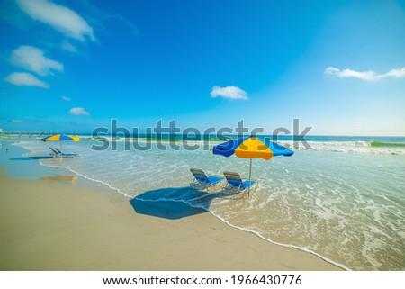 Parasols and beach chairs in Daytona Beach foreshore. Florida, USA Royalty-Free Stock Photo #1966430776