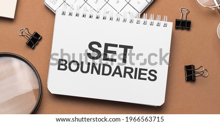 set boundaries on notepad with pen, glasses and calculator Royalty-Free Stock Photo #1966563715