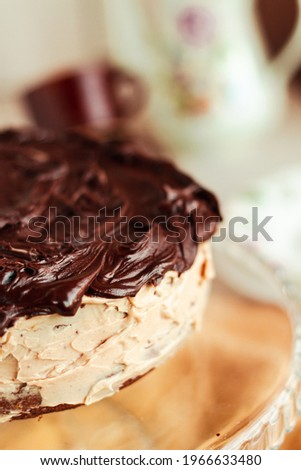 Delicious homemade dessert. Rich Dark Chocolate Cake.Moist, creamy and bitter chocolate taste. Best eaten fresh or refrigerated. Sweets for birthday concept. Royalty-Free Stock Photo #1966633480