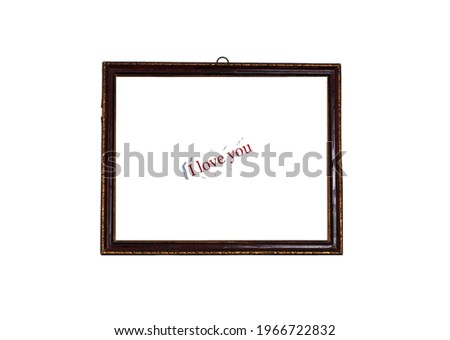 The concept of a love message on minimalism. Old photo frame. Caption - I love you. Isolated on white background.
