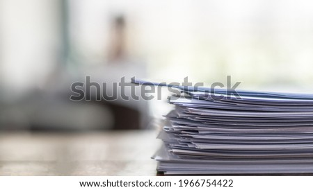 Exam answer sheet pile, blurry application document paperwork stack on office work table in examination room or classroom with blur education background school class university students taking test Royalty-Free Stock Photo #1966754422