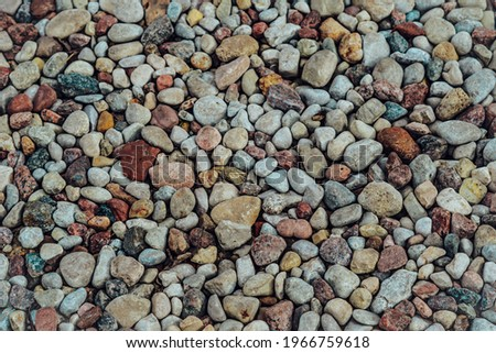 Small stone texture for background. High quality photo Royalty-Free Stock Photo #1966759618