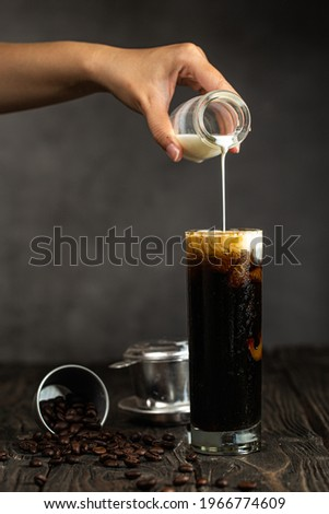 Vietnamese Iced Coffee with fresh milk in tall glass Royalty-Free Stock Photo #1966774609