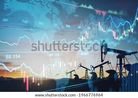 Rise in gasoline prices concept with double exposure of digital screen with financial chart graphs and oil pumps on a field Royalty-Free Stock Photo #1966776964