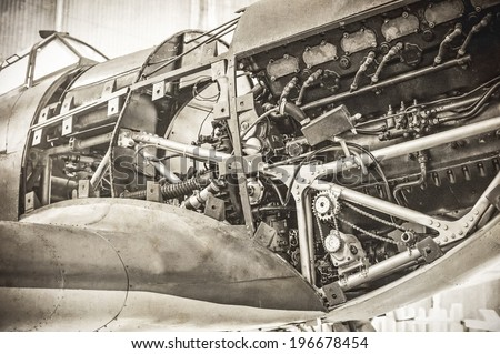 vintage styled WW2 fighter plane engine with added sepia tones and grain