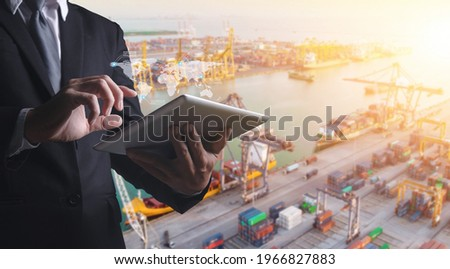 Douple exposures of Businessman touching tablet for analyze stock at logistics port and world map with logistic network distribution on background, transportation trading business concept,