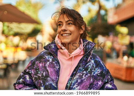 Young hispanic sporty woman smiling happy standing at the city.