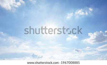 Picture of blue sky and white clouds. The sun during the day. Clear weather
