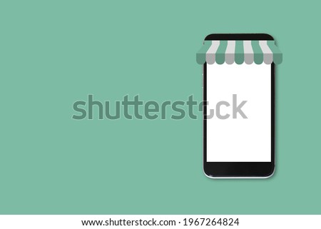 Smartphone blank white screen on green background with clipping path. Mockup mobile phone empty screen. online shopping concept.