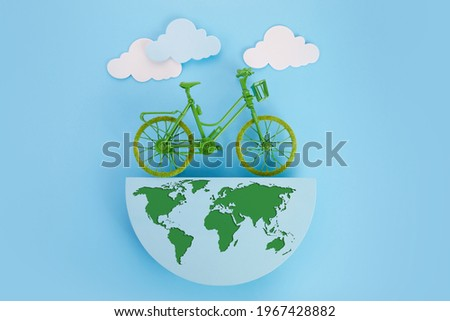 3rd June World Bicycle Day. Green bicycle and world. Environment preserve. Royalty-Free Stock Photo #1967428882