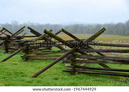 virginia worm wooden fence  in the historic  gettysburg battlefield along chambersburg road on a cloudy day in spring in pennsylvania Royalty-Free Stock Photo #1967444929