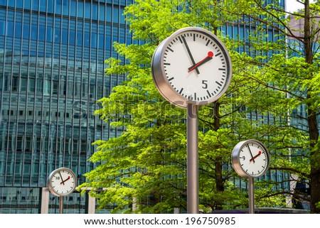 Clock in Canary Wharf. London, England Royalty-Free Stock Photo #196750985