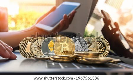 Bitcoin BTC cryptocurrency coin with altcoin digital crypto currency tokens, ETC Ethereum, ADA Cardano, LTC Litecoin, IOTA Miota,  ZEC Zcash for defi decentralized financial banking p2p global market Royalty-Free Stock Photo #1967561386