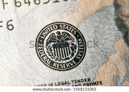 macro photo of federal reserve system symbol on hundred dollar bill. shallow focus. close-up with fine and sharp texture Royalty-Free Stock Photo #1968131083
