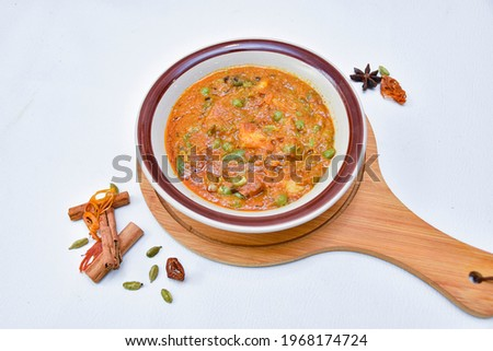 Mix vegetable curry with spicy and white background and wooden try
