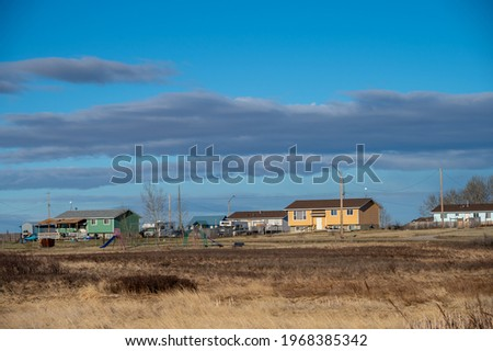 Homes on the Siksika Nation reservation in Alberta.  Royalty-Free Stock Photo #1968385342