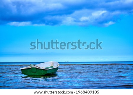 Small fishing boat with fishing net and equipment Royalty-Free Stock Photo #1968409105