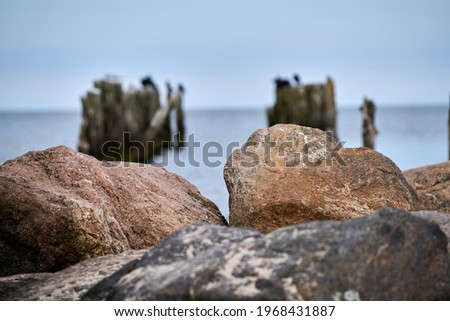 Old abandoned stone fishing pier called Bocahenge is L shaped and found in Boca Grande on Gasparilla Island in Florida Royalty-Free Stock Photo #1968431887