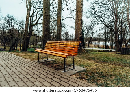 Lonely Bench in the City Park Royalty-Free Stock Photo #1968495496